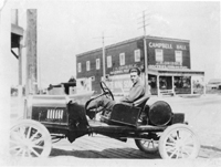 Wilmer Gribble and his car taken at Garvey and Garfield, 1918