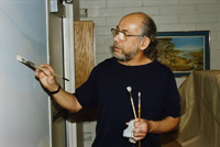 Armando Cabrera painting a mural in the Monterey Park museum