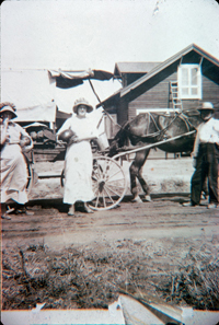 The green grocer delivers produce to 214 S. Garfield Avenue around 1912