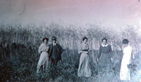 The Hunt family standing on the west side of Garfield Avenue opposite their home in 1914